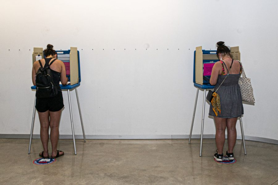 A pair of Johnson County citizens are seen anonymously voting in the The University of Iowa Visual Arts building on Tuesday, June 2, 2020. Counties all across Iowa along with eight other states are participating in the 2020 primary elections.