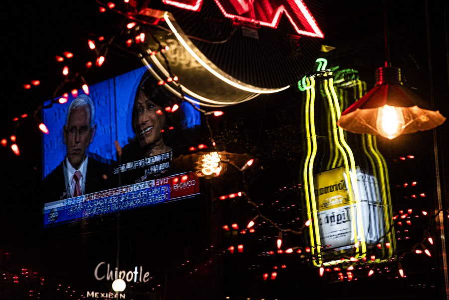 The Vice Presidential Debate plays on television inside Cactus 3 in downtown Iowa City on Wednesday, Oct. 7, 2020. The debate is between U.S. Sen. Kamala Harris, D-Calif. running alongside Democratic candidate Joe Biden and Vice President Mike Pence running alongside President Donald Trump.