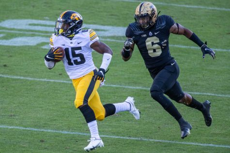 Iowa Hawkeyes running back Tyler Goodson (15) runs the ball while Purdue Boilermakers safety Jalen Graham (6) defends in the first quarter on Saturday, Oct. 24, 2020 at Ross-Ade Stadium. in West Lafayette, Indiana.