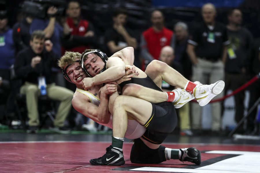 Iowa's 125-pound Spencer Lee grapples with Purdue's  Devin Schroder during the final session of the Big Ten Wrestling Tournament in Piscataway, NJ, on Sunday, March 8, 2020. Lee won by major decision 16-2, securing the 125-pound championship, and Iowa won the team title with 157.5 points..