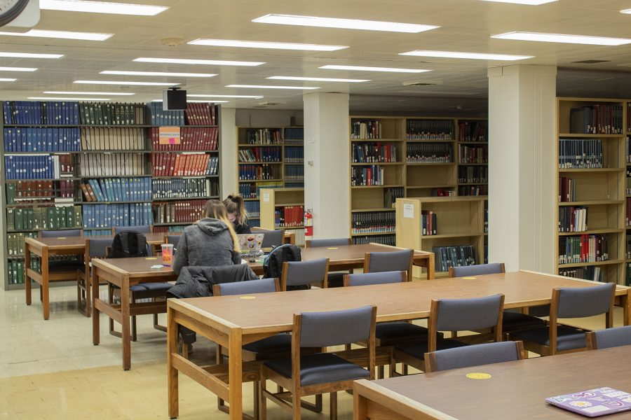 Pictured is the Main Library at the University of Iowa on Oct. 28, 2020. Many students in the library aren't' following the COVID-19 rules and regulations of the University, which requires students to wear masks and only sit a certain number of students to a table.