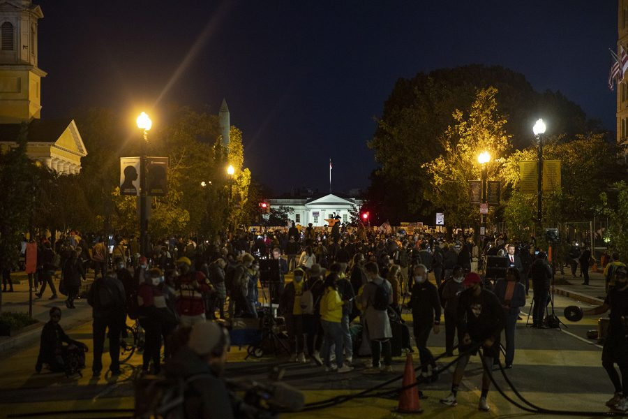 The crowd of protesters continues to grow as the sun goes down outside of the White House on Black Lives Matter Plaza on Tuesday, Nov. 3, 2020. Protests began to get violent as police handcuffed a man. Protesters gathered and the police threw a smoke bomb. Only a few blocks away, President Trump holds a private party in the White House. Later in the night, hundreds took to the streets to protest the election. The group lite off fireworks in the streets.