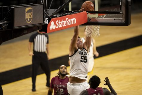 Iowa center Luka Garza dunks the ball during the second half of the first Iowa men's basketball game of the season against the North Carolina Central Eagles at Carver-Hawkeye Arena on Wednesday, Nov. 25, 2020. The Hawkeyes defeated Eagles 97-67. (Jenna Galligan/The Daily Iowan)