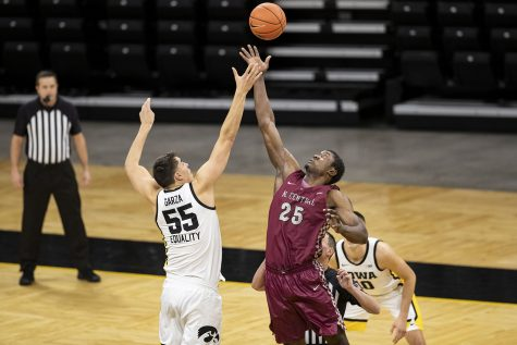 Iowa center Luka Garza jumps up for the tipoff during the first Iowa men's basketball game of the season against the North Carolina Central Eagles at Carver-Hawkeye Arena on Wednesday, Nov. 25, 2020. North Carolina Central gained the first posession. The Hawkeyes defeated the Eagles 97-67.