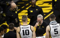 Iowa Head Coach Fran McCaffery adjusts his mask during a timeout during the first Iowa men's basketball game of the season against the North Carolina Central Eagles at Carver-Hawkeye Arena on Wednesday, Nov. 25, 2020. The Hawkeyes defeated the Eagles 97-67.