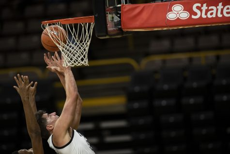 Iowa center Luka Garza makes a shot during the Iowa men's basketball game against the Southern University Jaguars at Carver-Hawkeye Arena on Friday, Nov. 27, 2020. The Hawkeyes defeated the Jaguars 103-76 in their first game against them since 2017. (Jenna Galligan/The Daily Iowan)