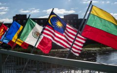Various flags are seen on Monday, October 15, 2018. There are 120 flags being displayed on the Iowa Memorial Union Pedestrian Bridge to recognize the international students on campus.