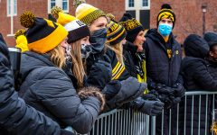 Hawkeye fans gather outside of Kinnick Stadium and cheer for the Iowa football team as they head into the stadium before the game against Nebraska on Friday, Nov. 27, 2020.