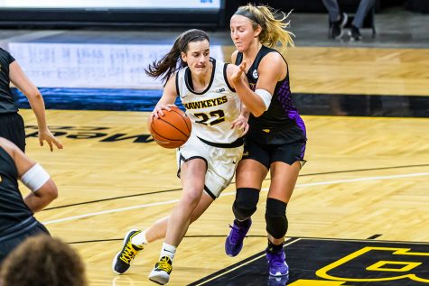 Caitlin Clark runs the ball down the court during the Iowa Hawkeyes Women's Basketball season opener again Northern Iowa on Nov. 25, 2020. The Hawkeyes defeated Northern Iowa 96-81.