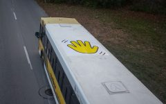 A University of Iowa Cambus, driving on South Riverside Drive on Nov. 18, has a wave decal on top of the bus to wave to kids when it drives by Stead Family's Children Hospital.