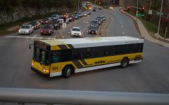 A University of Iowa Cambus, at the intersection of West Iowa Avenue and South Riverside Drive on Nov. 18, has a wave decal on top of the bus to wave to kids when it drives by Stead Family's Children Hospital.