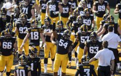 Iowa Defensive Tackle Daviyon Nixon raises his fist as the Hawkeyes take to their home field for the first time in the season during the Iowa v Northwestern football game at Kinnick Stadium on Saturday, Oct. 31, 2020.  The Wildcats defeated the Hawkeyes 21-20.