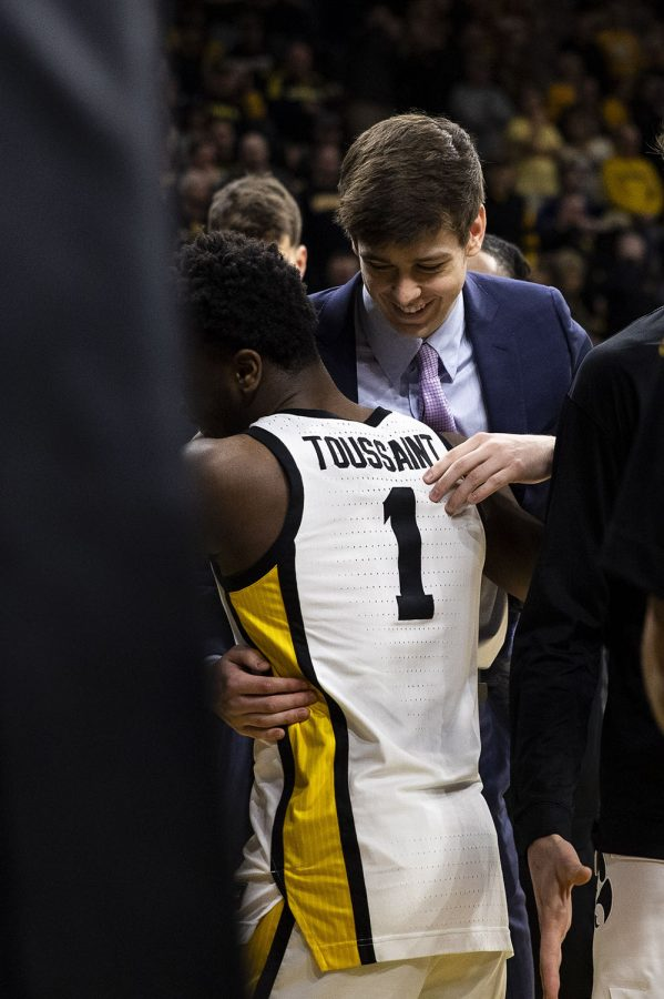 Iowa freshmen Patrick McCaffery and Joe Toussaint hug before a men's basketball game between Iowa and Penn State on Saturday, Feb. 29 at Carver-Hawkeye Arena. The Hawkeyes defeated the Nittany Lions 77-68.