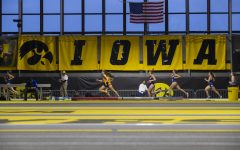 Runners compete in the mile run premier during the Black and Gold Invitational at the University of Iowa Recreation Building on Saturday, Feb. 1, 2020. Grace Rowan of Eastern Illinois led the field with a time of 4:56.26.