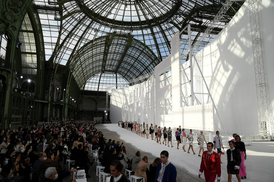 Models wear creations for the Chanel spring/summer 2021 fashion show Oct. 6 during Paris Fashion Week. The show was hosted at the Grand Palais.