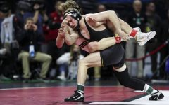 Iowas 125-pound Spencer Lee grapples with Purdues  Devin Schroder during the final session of the Big Ten Wrestling Tournament in Piscataway, NJ, on Sunday, March 8, 2020. Lee won by major decision 16-2, securing the 125-pound championship, and Iowa won the team title with 157.5 points.
