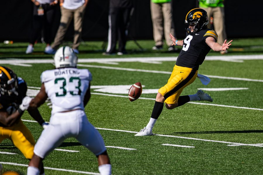 Iowa+punter+Tory+Taylor+kicks+the+ball+during+a+football+game+between+Iowa+and+Michigan+State+in+Kinnick+Stadium+on+Saturday%2C+Nov.+7%2C+2020.+The+Hawkeyes+dominated+the+Spartans%2C+49-7.+