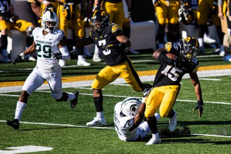 Iowa running back Tyler Goodson carries the ball during a football game between Iowa and Michigan State in Kinnick Stadium on Saturday, Nov. 7, 2020. The Hawkeyes dominated the Spartans, 49-7.