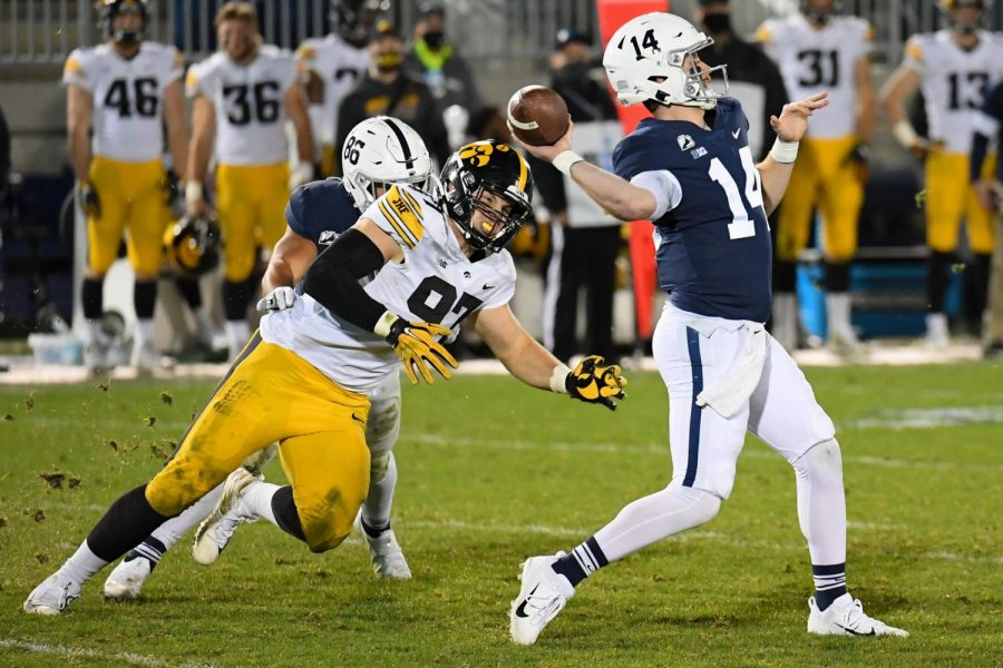 Nov+21%2C+2020%3B+University+Park%2C+Pennsylvania%2C+USA%3B+Penn+State+Nittany+Lions+quarterback+Sean+Clifford+%2814%29+passes+the+ball+as+Iowa+Hawkeyes+defensive+lineman+Zach+VanValkenburg+%2897%29+pressures+during+the+third+quarter+at+Beaver+Stadium.+Mandatory+Credit%3A+Rich+Barnes-USA+TODAY+Sports
