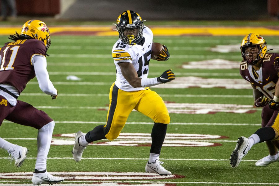 Nov 13, 2020; Minneapolis, Minnesota, USA; Iowa Hawkeyes running back Tyler Goodson (15) rushes with the ball for a first down in the first half against the Minnesota Golden Gophers at TCF Bank Stadium. (Jesse Johnson-USA TODAY)