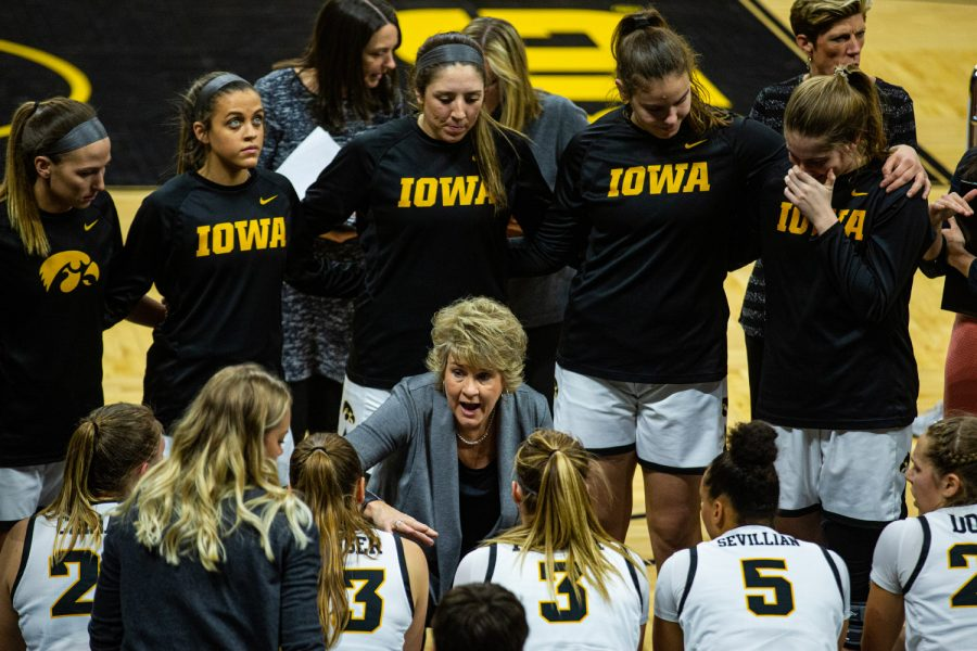 Iowa head coach Lisa Bluder talks to her team during a women's basketball match between Iowa and Indiana at Carver-Hawkeye Arena on Sunday, Jan. 12, 2020. The Hawkeyes defeated the Hoosiers, 91-85, in double overtime.
