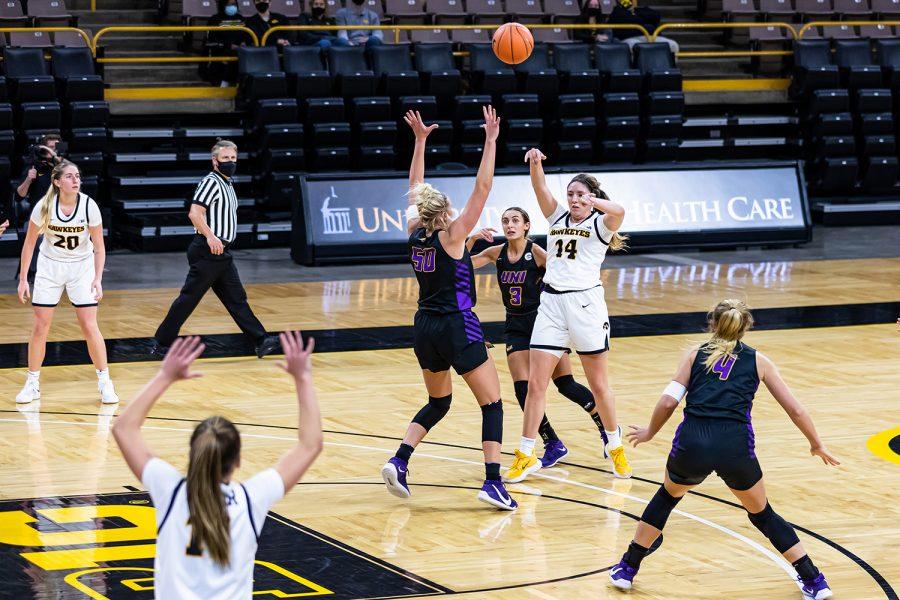 Iowa's McKenna Warnnock passes the ball during the Iowa Hawkeyes Women's Basketball season opener against Northern Iowa on Nov. 25, 2020. The Hawkeyes defeated Northern Iowa 96-81.