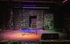 A silent mic along with an empty chair sits on the stage at Gabe's on Friday, Oct. 30, 2020. A stage that once was alive with music is now quiet due to Covid-19 restrictions.