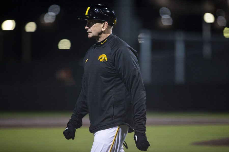 Iowa head coach Rick Heller watches the game from third base during a baseball game between Iowa and Grand View on March 3, 2020. The Hawkeyes defeated the Vikings 15-2.