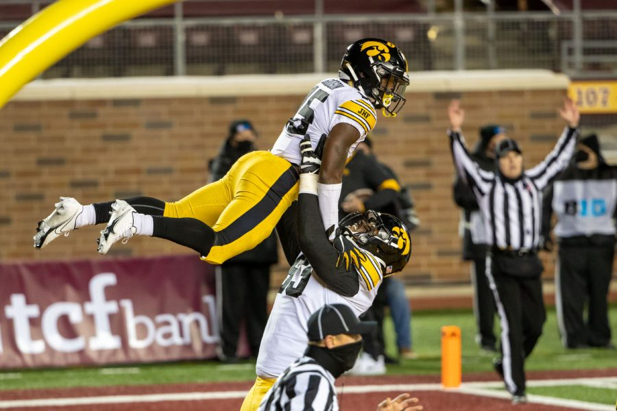 Iowa Hawkeyes running back Tyler Goodson (15) celebrates with offensive lineman Justin Britt (63) after scoring a touchdown in the first half against the Minnesota Golden Gophers on Friday, Nov. 13, 2020 at TCF Bank Stadium in Minneapolis. (Jesse Johnson/USA TODAY Sports)