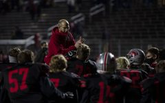 City High head coach Dan Sabers congratulates the team after the first varsity football playoff game between City High and Ottumwa on Friday, Oct. 16, 2020 at Frank Bates Field. The Little Hawks defeated the Bulldogs with a score 41-16. At the beginning of the game, announcers told the crowd to wear masks and practice social distancing.