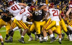 Iowa center Tyler Linderbaum throws a block during the 2019 SDCCU Holiday Bowl between Iowa and USC in San Diego on Friday, Dec. 27, 2019. The Hawkeyes defeated the Trojans, 49-24.