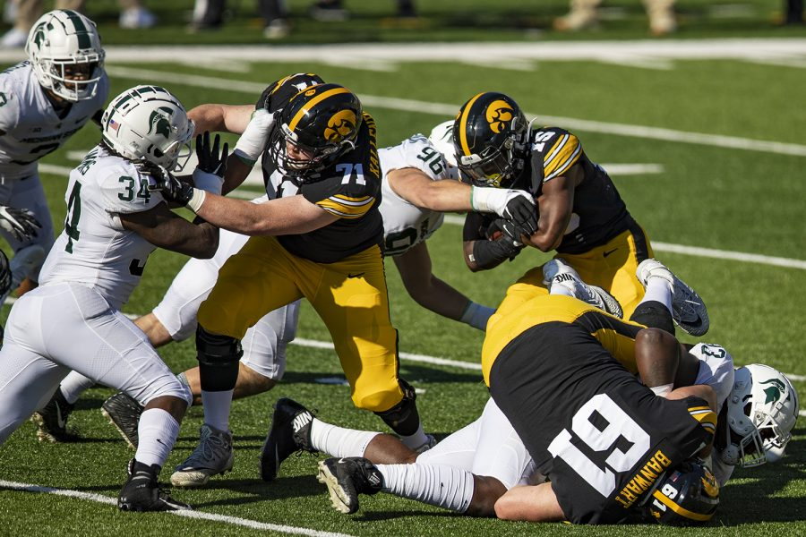 Iowa+running+back+Tyler+Goodson+carries+the+ball+during+a+football+game+between+Iowa+and+Michigan+State+in+Kinnick+Stadium+on+Saturday%2C+Nov.+7%2C+2020.