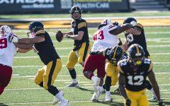 Iowa quarterback Spencer Petras looks to pass during a football game between Iowa and Nebraska at Kinnick Stadium on Friday, Nov. 27, 2020. (Shivansh Ahuja/The Daily Iowan)