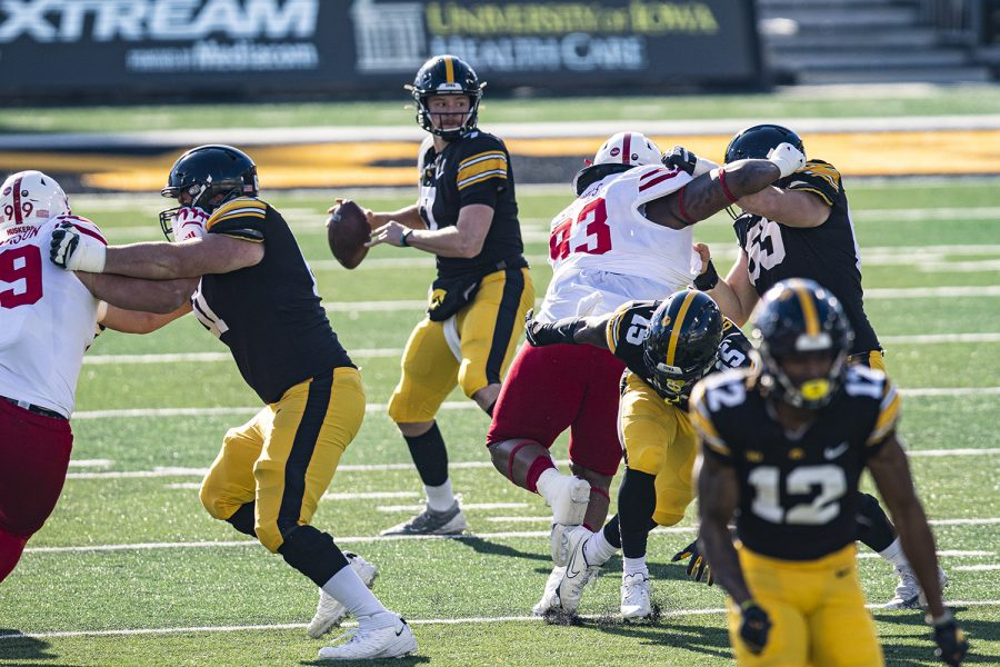 Iowa quarterback Spencer Petras looks to pass during a football game between Iowa and Nebraska at Kinnick Stadium on Friday, Nov. 27, 2020. (Shivansh Ahuja/The Daily Iowan)