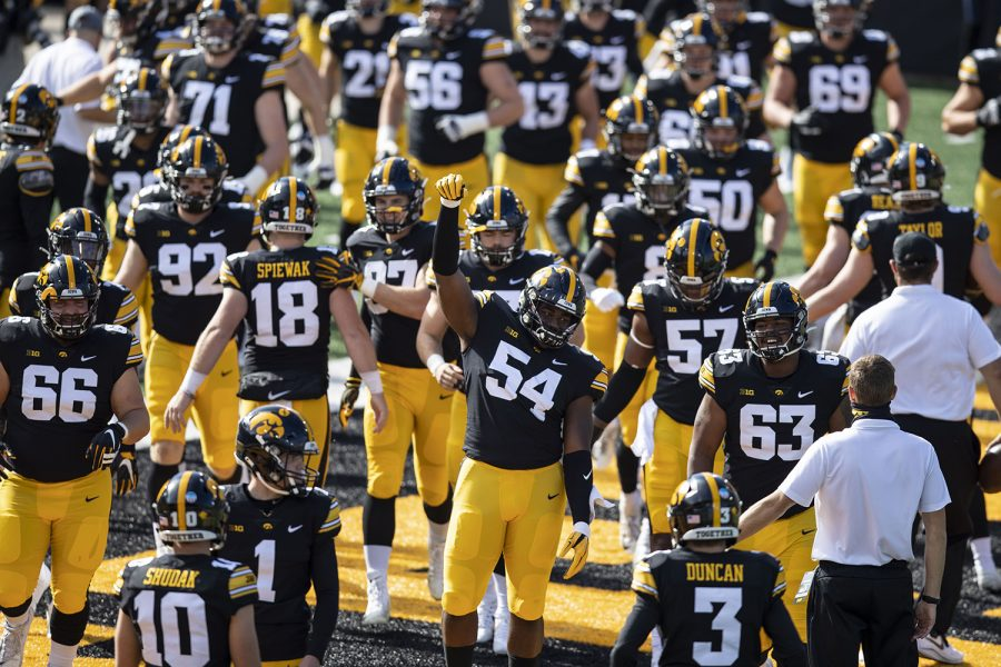 Iowa+Defensive+Tackle+Daviyon+Nixon+raises+his+fist+as+the+Hawkeyes+take+to+their+home+field+for+the+first+time+in+the+season+during+the+Iowa+v+Northwestern+football+game+at+Kinnick+Stadium+on+Saturday%2C+Oct.+31%2C+2020.++The+Wildcats+defeated+the+Hawkeyes+21-20.