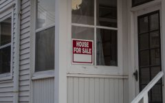A For Sale sign is seen on Tuesday, Nov. 17,  2020. With families wanting larger homes to inhabit while being stuck at home due to COVID-19, real estate companies are doing notably well.