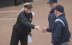 Iowa head coach Renee Gillispie shakes hands with the umpires before the conference opening softball game at Pearl Field on Friday, March 29, 2019. This is Gillispie's first season coaching the Hawkeyes. The Wildcats defeated the Hawkeyes 5-0.