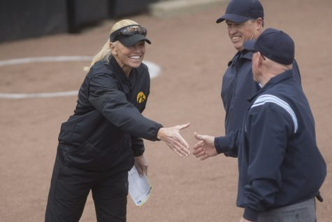 Iowa head coach Renee Gillispie shakes hands with the umpires before the conference opening softball game at Pearl Field on Friday, March 29, 2019. This is Gillispie