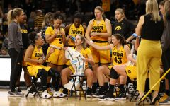 The Iowa Women's Basketball team huddles up on a time out during a basketball game against Michigan State on Thursday, Feb. 7, 2019. The Hawkeyes defeated the Spartans 86-71.