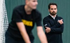 Iowa head coach Ross Wilson watches his team during a men's tennis match between Iowa and Texas Tech at the HTRC on Thursday, Jan. 16, 2020. The Red Raiders defeated the Hawkeyes, 4-3.