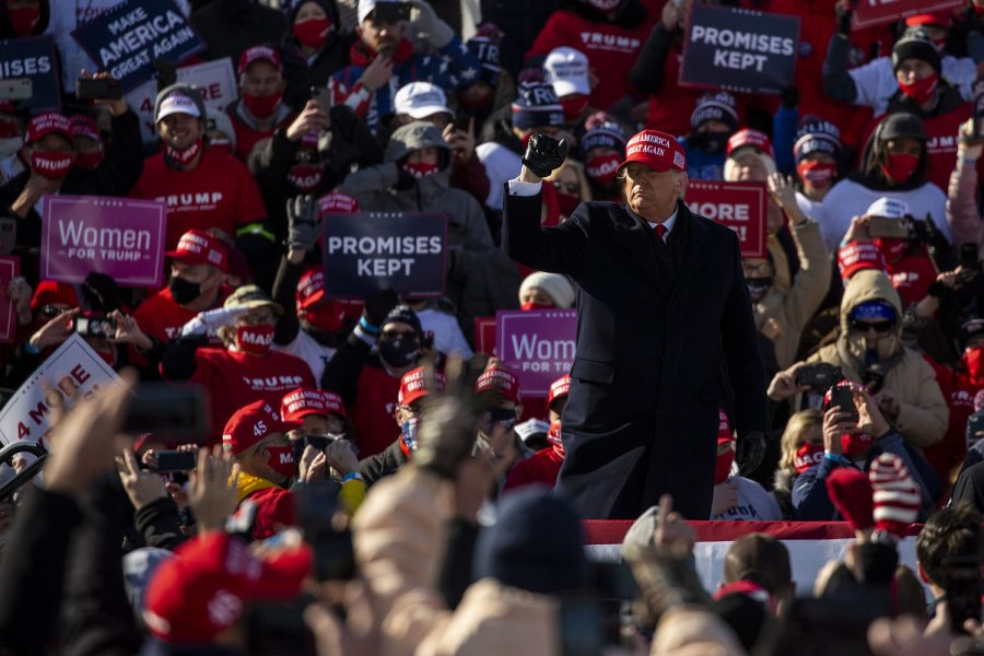 """President Donald Trump walks around the stage to music during a """"Make America Great Again"""" rally held at the Dubuque Regional Airport on Sunday, November 1, 2020. With two days before Election Day, this is President Trump's second stop to Iowa in the past few weeks."""