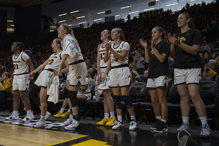 Iowa players celebrate after scoring during a women's basketball game between Iowa and Penn State at Carver Hawkeye Arena on Saturday, Feb. 22, 2020. The Hawkeyes defeated the Nittany Lions, 100-57.