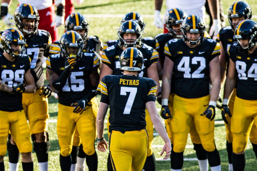 Iowa quarterback Spencer Petras leads a huddle during a football game between Iowa and Nebraska at Kinnick Stadium on Friday, Nov. 27, 2020.