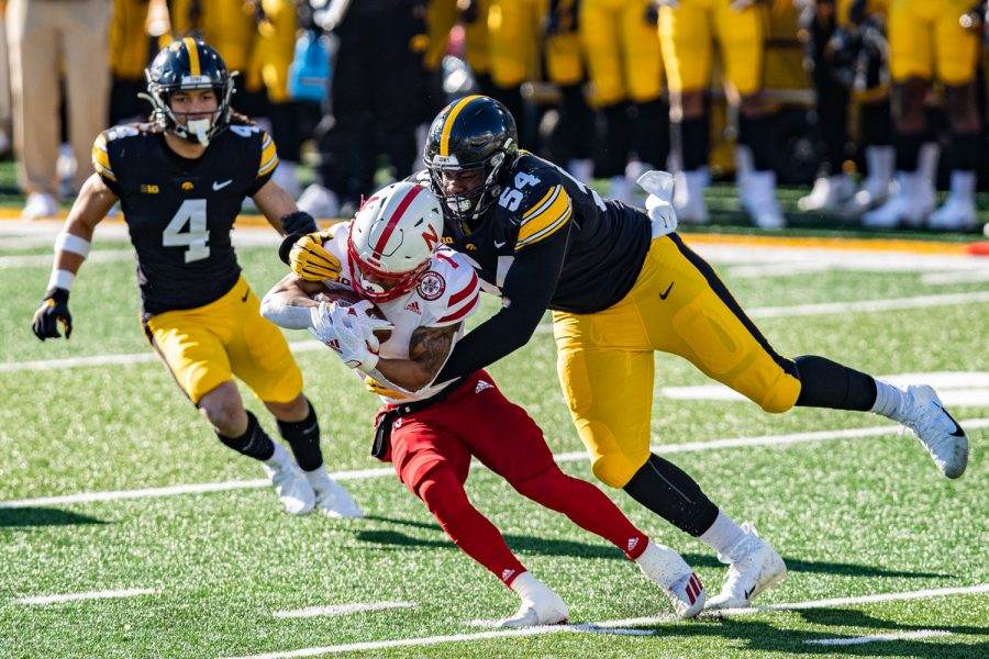 Iowa defensive tackle Daviyon Nixon tackles Nebraska's WanÕDale Robinson during a football game between Iowa and Nebraska at Kinnick Stadium on Friday, Nov. 27, 2020. IowaÕs defense sacked Martinez three times.