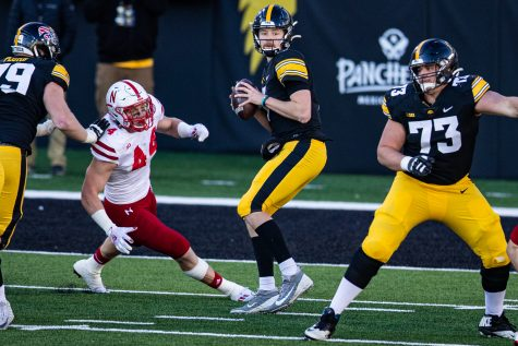 Iowa quarterback Spencer Petras attempts a pass during a football game between Iowa and Nebraska at Kinnick Stadium on Friday, Nov. 27, 2020. Petras moves to 4-2 as IowaÕs starter this season.