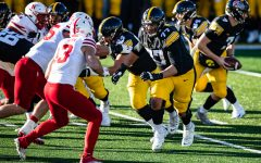 Iowa tackle Alaric Jackson throws a block during a football game between Iowa and Nebraska at Kinnick Stadium on Friday, Nov. 27, 2020. Hawkeye quarterback Spencer Petras was only sacked once on the day.
