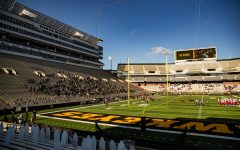 Spectators and players do the Hawkeye Wave during a football game between Iowa and Nebraska at Kinnick Stadium on Friday, Nov. 27, 2020.