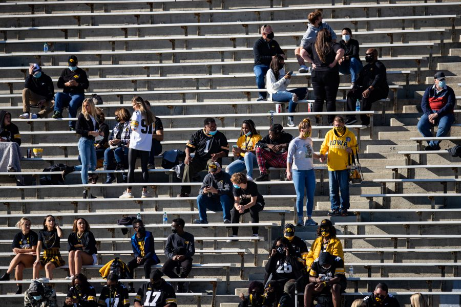 Friends and family of players and coaches take their seats during a football game between Iowa and Michigan State in Kinnick Stadium on Saturday, Nov. 7, 2020. The Hawkeyes dominated the Spartans, 49-7. Official attendance for the game was tallied at 1,441.