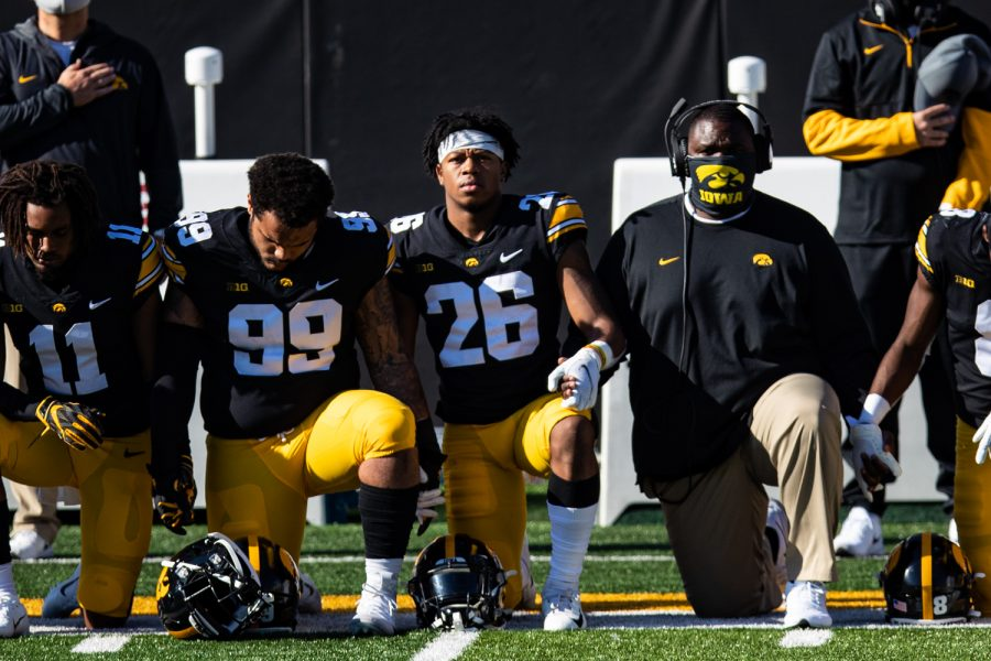 Iowa's Kaevon Merriweather kneels for the anthem during a football game between Iowa and Michigan State in Kinnick Stadium on Saturday, Nov. 7, 2020. The Hawkeyes dominated the Spartans, 49-7.
