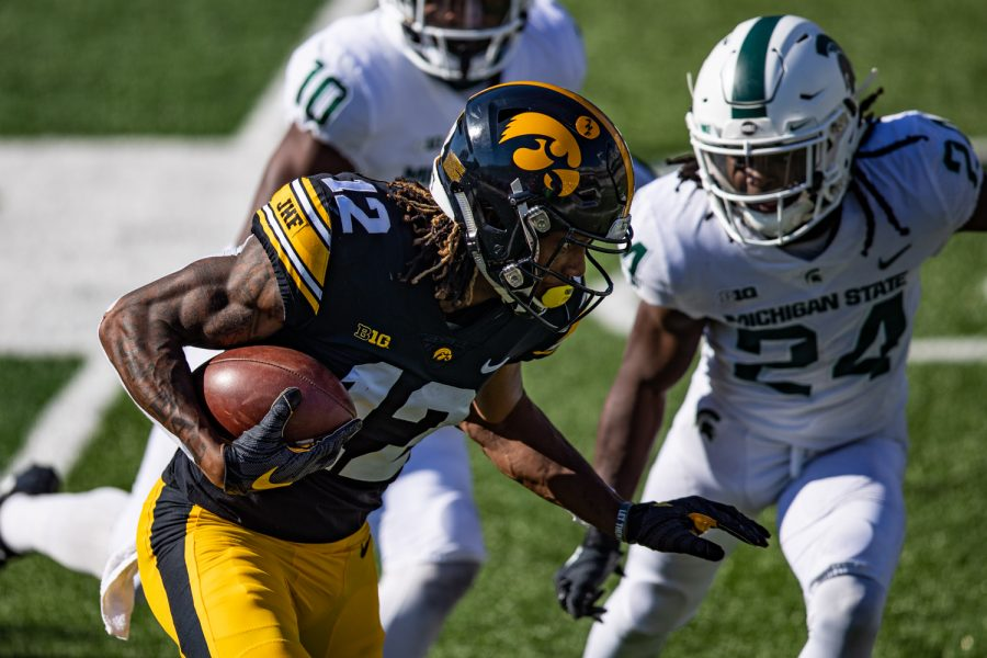 Iowa wideout Brandon Smith runs after a catch during a football game between Iowa and Michigan State in Kinnick Stadium on Saturday, Nov. 7, 2020. The Hawkeyes dominated the Spartans, 49-7. Smith caught Petras lone touchdown pass.
